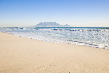 Table Mountain - the world famous landmark in Cape Town, South Africa. Picture taken on a clear Winters day from the Blouberg Strand beach. Stock Photo - 4107945