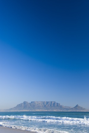 Table Mountain - the world famous landmark in Cape Town, South Africa. Picture taken on a clear Winters day from the Blouberg Strand beach. Ample space on top for copy text.