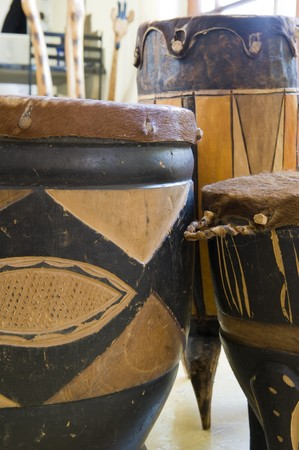 african drums: A selection of ornate African drums made of wood and animal skin.
