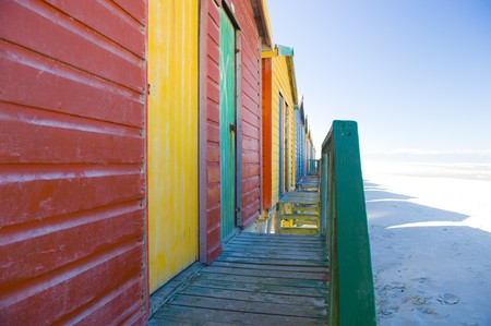Brightly colored dressing huts on Muizenberg beach near Cape Town. Stock Photo - 4130306