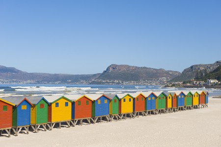 Brightly colored dressing huts on Muizenberg beach near Cape Town. photo