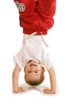 An adorable three year old doing a handstand. Stock Photo - 4124903