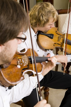 Professional violinists performing as part of a string quartet. Stock Photo