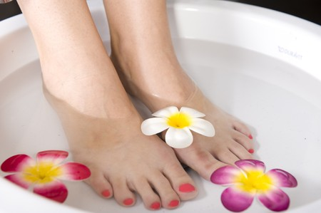 A lady having a pedicure treatment in a spa.