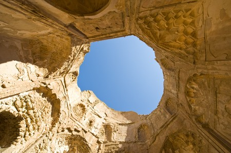 thriving: The ancient 13th century ruins of the mosque built by Bibi Maryam, located in the once thriving merchant city of Qalhat in Oman. Wide angle view from the inside through the destroyed roof.