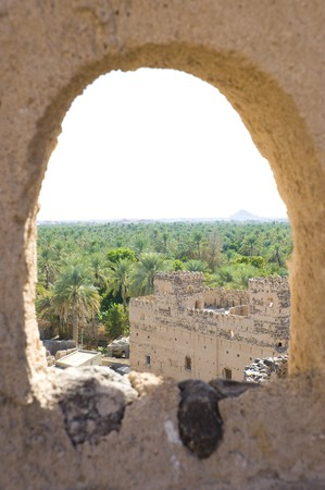 watchtower: Ancient ruins from multiple tribal wars in Al Mudayrib in Oman. Viepoint from the top of a watchtower through a hole in the wall.