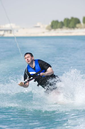 A wakeboarder falling while riding the wakeboard. photo