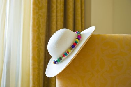 Inside of a luxuus hotel room with a Panama hat on the bed. Stock Photo - 4744162