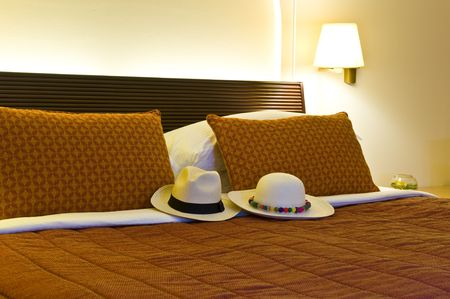 Inside of a luxurious hotel room with a Panama hat on the bed. Stock Photo - 4744163