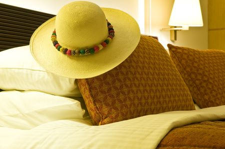 Inside of a luxurious hotel room with a Panama hat on the bed. Stock Photo - 4972070
