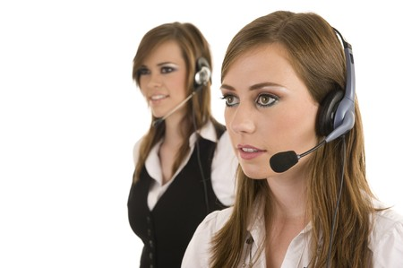 live happy: Young business ladies with headsets. Studio on isolated white background.