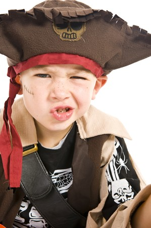 trick: Young boy in pirate costume playing trick or treat for Halloween. Stock Photo