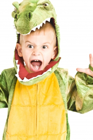 crocodiles: Kids in Halloween costumes playing trick or treat and asking for sweets. Stock Photo