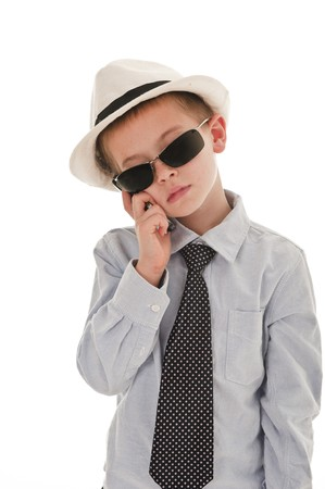 be dressed in: A small boy in the studio, dressed up in a suit and pretending to be a businessman. Stock Photo