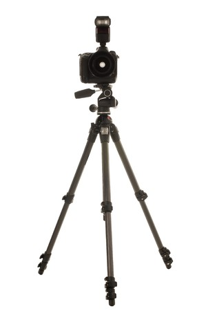 A carbon fibre tripod with pan and tilt head, fitted with a professional DSLR with external flash. photo