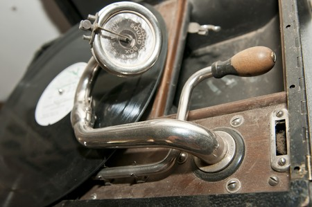 gramaphone: A dusty old gramaphone with a record on the turntable.