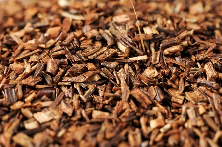 Macro studio shot of dry antioxidant rich healthy herbal rooibos tea from the Western Cape region in South Africa. photo