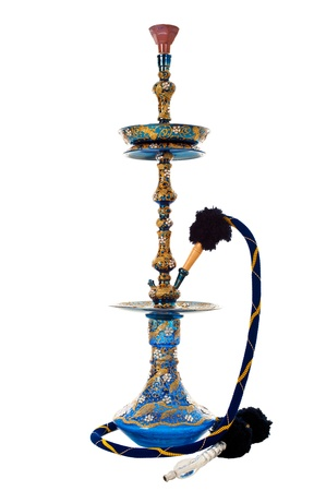 An ornate Syrian sheesha or hooka water pipe with a ceramic head, isolated on white.