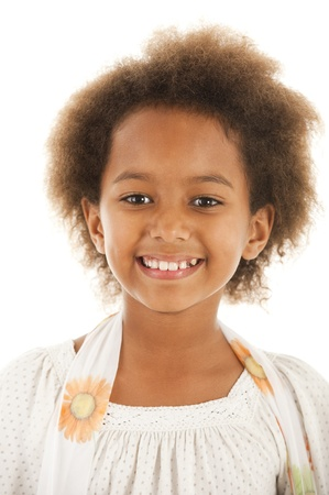 A gorgeous little 7yr old African girl in the studio.  White background. Stock Photo - 9111530