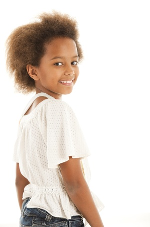 A gorgeous little 7yr old African girl in the studio.  White background. Stock Photo - 9111524