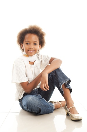A gorgeous little 7yr old African girl in the studio.  White background. photo