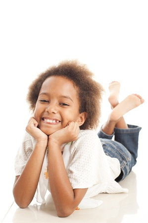 happy african: A gorgeous little 7yr old African girl in the studio.  White background. Stock Photo