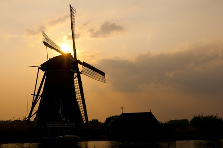 A windmill silhouette against the evening sunset. Stock Photo - 9535332