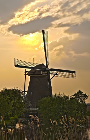HDR image of windmills in the evening sunset after the rain. Stock Photo - 9535309