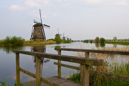 Windmills in the evening sunset after the rain. Stock Photo - 9535342