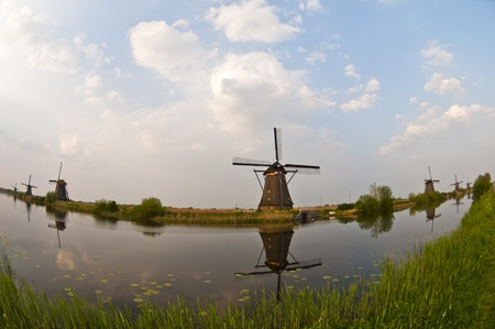 Fisheye view of windmills in the evening sunset after the rain. Stock Photo - 9535269