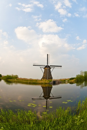 Fisheye view of a windmill in the evening sunset after the rain. Stock Photo - 9535275
