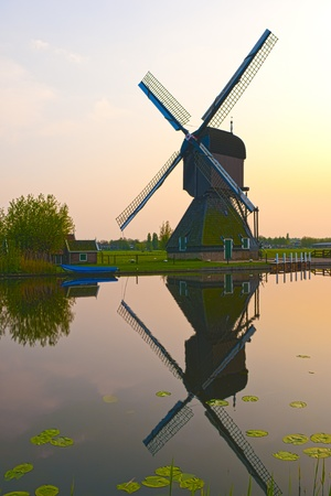 HDR image of windmills in the evening sunset after the rain. Stock Photo - 9535303