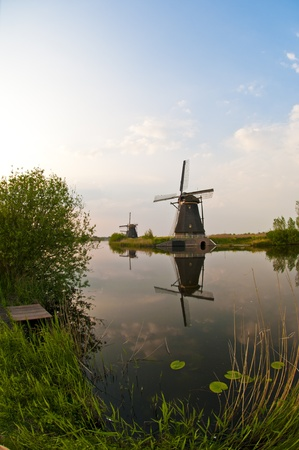 Windmills in the evening sunset after the rain. Stock Photo - 9535343