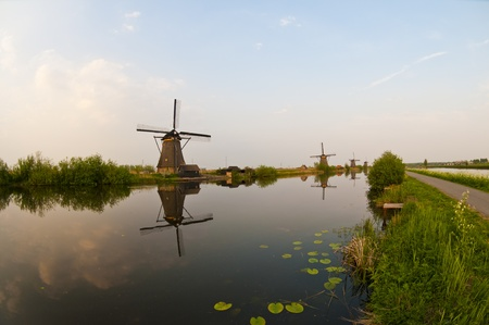 Windmills in the evening sunset after the rain. Stock Photo - 9535302