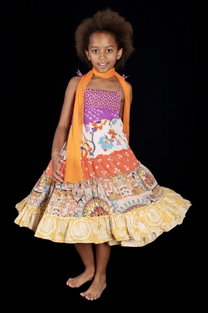 A gorgeous little 7yr old African girl in the studio. Black background. Stock Photo - 9535336