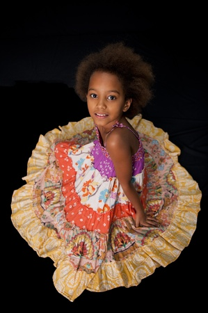 A gorgeous little 7yr old African girl in the studio. Black background. Stock Photo - 9535335