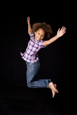 adolescent african american: A gorgeous little 7yr old African girl in the studio. Black background.