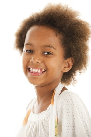 black children: A gorgeous little 7yr old African girl in the studio.  White background. Stock Photo