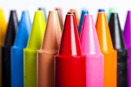 A stack of colorful crayons on an isolated white background. Stock Photo