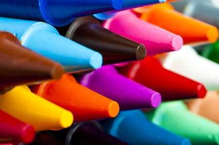 A stack of colorful crayons on an isolated white background. Stockfoto