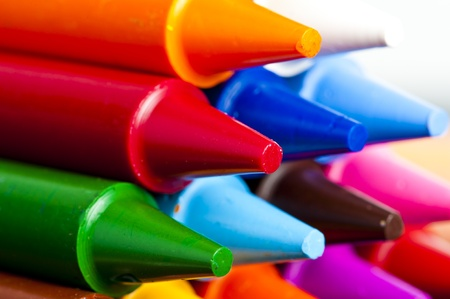A stack of colorful crayons on an isolated white background. photo