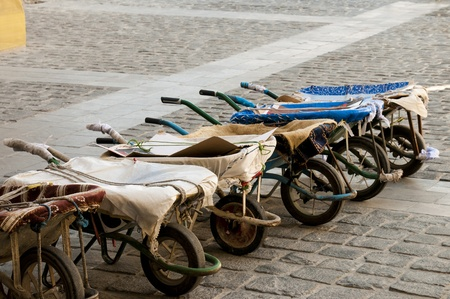 souq: A row of wheelbarrows used by porters at the Doha souq. Stock Photo