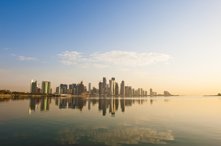 The Arabian city of Doha in Qatar, where the skyline changed drastically over the past 5 years. This image was captured early in the morning with the sun rising from the right and some rare fluffy clouds in the sky..