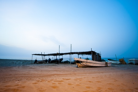 muscat: Slow shutter fishing boat in the evening on a beach in Oman Stock Photo