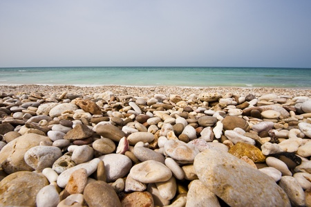 Pebble Beach: Pebble beach on the coast in Oman. Stock Photo
