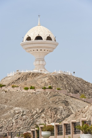 muscat: Landmark incense burner structure in Muttrah, Oman, next to the corniche at the traditional souq and harbor of Muscat. Stock Photo