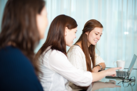 Business meeting between ladies with a laptop on the table  photo