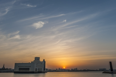 persian gulf: Museum of Islamic Art in Doha agains the setting sun