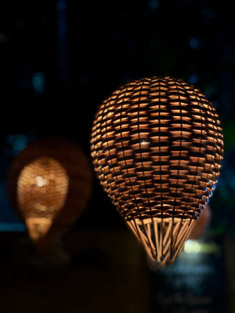 Beautifully lit straw lanterns hanging from the top