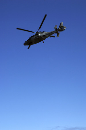 sniper training: French army helicopter named Panther on blue sky background